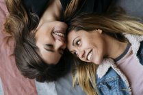 Smiling laying women couple — Stock Photo