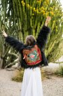 Back view of female in cacti — Stock Photo