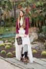 Woman posing in cacti — Stock Photo