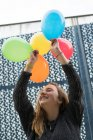 Young woman with balloons — Stock Photo