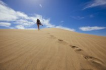 Woman in dress at the dunes — Stock Photo