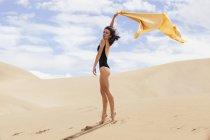 Sensual woman in dunes — Stock Photo