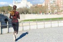 Healthy woman jogging — Stock Photo