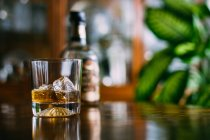 Glass of whiskey on the rocks — Stock Photo