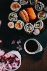 Sushi served on wooden table — Stock Photo