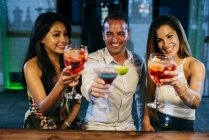 People drinking cocktails and toasting — Stock Photo