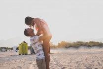 Happy couple on beach — Stock Photo
