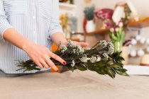 Crop woman arranging flowers — Stock Photo
