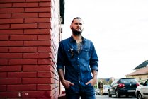 Handsome stylish man posing on street — Stock Photo
