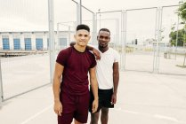 Young sportive men posing in squat — Stock Photo