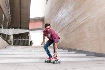 Stylish young skateboarder — Stock Photo