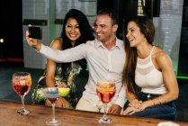 People taking selfie in bar — Stock Photo
