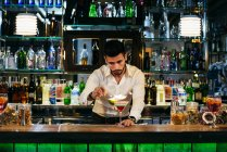 Bartender taking away green — Stock Photo
