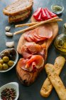 Board with snacks and appetizers — Stock Photo