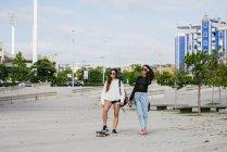 Trendy girls on skateboards — Stock Photo