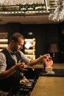 Barman Preparing a Strawberry Cocktail — Stock Photo