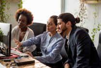 Multi-ethnic business people at work place in modern office — Stock Photo