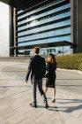 Rear view of business couple walking in Street — Stock Photo