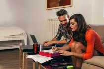 Young Couple Working at Home — Stock Photo