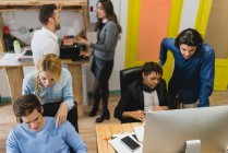 Working process of multi-ethnic business people in trendy office — Stock Photo