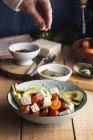 Tomato salad with feta cheese, avocados — Stock Photo