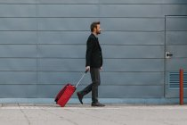 Businessman with a Red Suitcase — Stock Photo