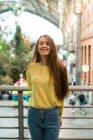 Smiling woman at handrail — Stock Photo