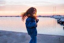 Cute woman waving hair at sunset — Stock Photo