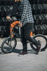Man walking with BMX bike — Stock Photo