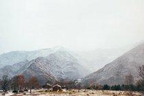 Winter village in mountains — Stock Photo