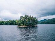 Island on mountain lake — Stock Photo