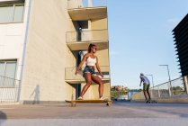 People riding skateboards at street — Stock Photo