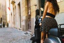 Crop stylish woman on scooter — Stock Photo