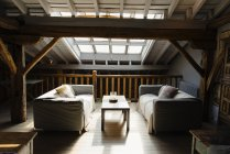 Interior of cozy mansard room — Stock Photo