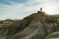 Women posing on cliff — Stock Photo