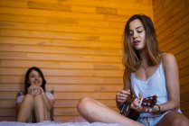 Girls spending time together in bedroom — Stock Photo