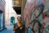 Smiling woman in alley — Stock Photo
