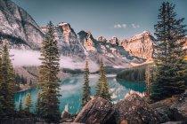 Glacial lake in snowy mountains — Stock Photo