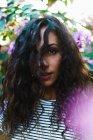 Sensual girl in blooming trees — Stock Photo