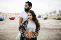 Embracing couple looking away — Stock Photo