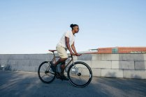 Black man riding bicycle — Stock Photo