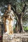 Statue of king in Alcazar of Christian kings at park — Stock Photo