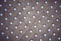 Full frame of metal panel floor with rivets. — стокове фото