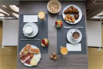 Top view of table with served breakfast — Stock Photo
