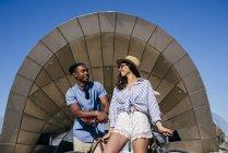 Couple leaning on bike — Stock Photo