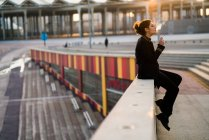 Woman sitting and handrail and smoking cigarette — Stock Photo