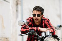 Man in sunglasses sitting on bike — Stock Photo