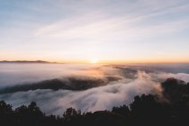 Aerial view of cloudscape in mountains at sunset — Stock Photo