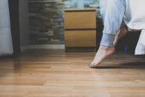 Female feets stepping on floor from bed — Stock Photo