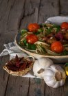 Spaghetti and meatballs garnished with basil leaves and grilled tomatoes on platter — Stock Photo